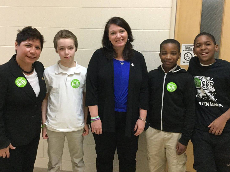 Nicole Hockley with an educator and students wearing Start With Hello stickers.