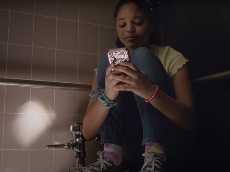 Still image of actress Symera Jackson in school bathroom stall