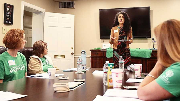 Woman presenting in a meeting for SHP