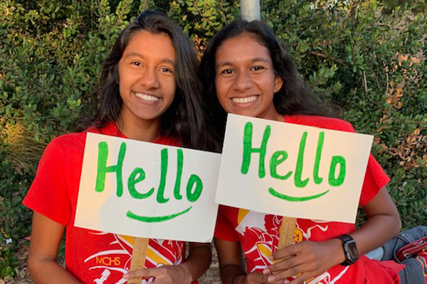 Students from Carmel High School in California holding Hello Signs